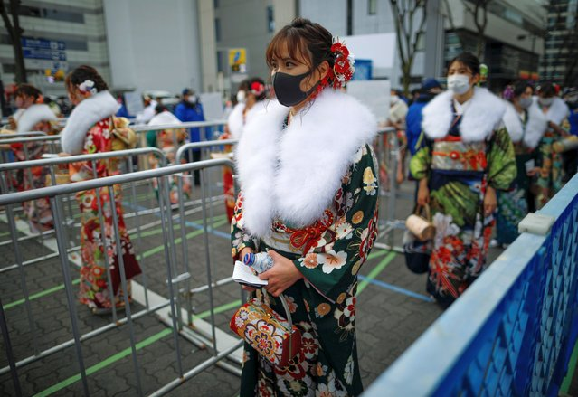 Kimono-clad women wearing protective face masks wait to receive their body temperature check as they attend their Coming of Age Day celebration ceremony at Yokohama Arena during the government declared the second state of emergency for the capital and some prefectures, amid the coronavirus disease (COVID-19) outbreak, in Yokohama, south of Tokyo, Japan on January 11, 2021. Of Tokyo's 23 wards, all but one have canceled or postponed the ceremonies, opting instead to offer mayors' congratulatory remarks online. The government last week declared a state of emergency for the capital and three surrounding prefectures. (Photo by Issei Kato/Reuters)