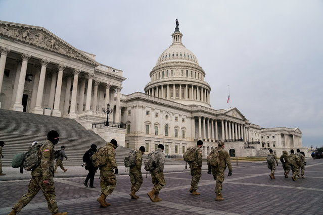 Members of the National Guard arrive to the U.S. Capitol days after supporters of U.S. President Donald Trump stormed the Capitol in Washington, U.S. January 11, 2021. (Photo by Erin Scott/Reuters)