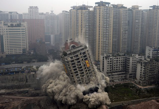 The 22-storey Yixin Mansion collapses after demolition by explosives as part of a urbanization project in Chongqing, January 14, 2015. (Photo by Reuters/China Daily)