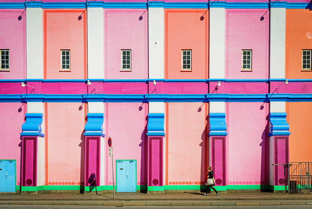 """Neon"". A young woman passes by the Palads theatre in Copenhagen, Denmark. (Photo and caption by Marcin Mokrzewski/National Geographic Traveler Photo Contest)"