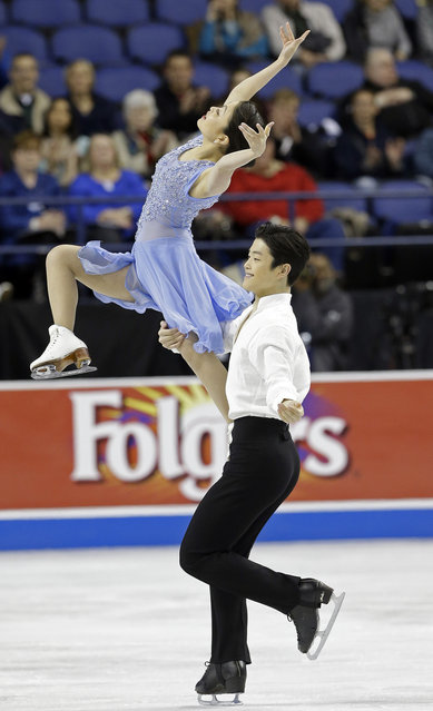 Alex Shibutani lifts Maia Shibutani while they perform during the free dance program in the U.S. Figure Skating Championships in Greensboro, N.C., Saturday, January 24, 2015. (Photo by Gerry Broome/AP Photo)