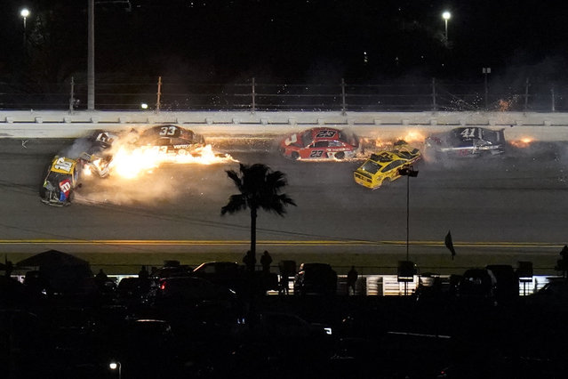Racers crash during the last lap in the NASCAR Daytona 500 auto race at Daytona International Speedway, Monday, February 15, 2021, in Daytona Beach, Fla. Joey Logano (22) was leading before the wreck; Brad Keselowski (2) was in second. (Photo by Chris O'Meara/AP Photo)