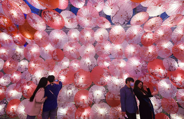"""Thousands of """"Umbrella Lantern"""" are seen along the streets in Hangzhou City, east China's Zhejiang Province, 22 February 2021. The installation is set up for the upcoming Spring Lantern Festival. (Photo by Rex Features/Shutterstock)"""