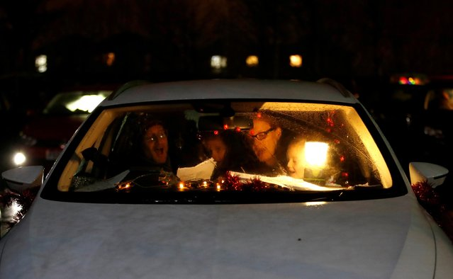 People sing as they attend a drive-in carol service organised by the Watling Valley Churches, amid the coronavirus disease (COVID-19) outbreak, in Milton Keynes, Britain, December 13, 2020. (Photo by Andrew Boyers/Reuters)