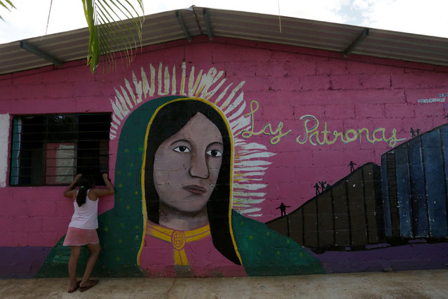 "A girl talks to a person (not pictured) at the premises of a group called ""Las Patronas"" (The bosses), a charitable organization that feeds Central American immigrants on their way to the border with the United States who travel atop a freight train known as ""La Bestia"", in Amatlan de los Reyes, in Veracruz state, Mexico October 22, 2016. (Photo by Daniel Becerril/Reuters)"