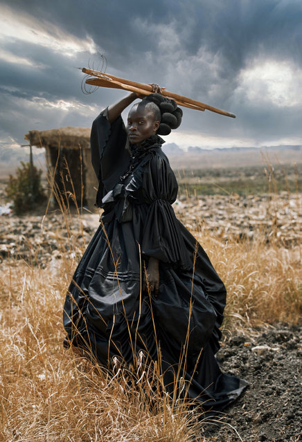 Category winner, open competition, creative. African Victorian, a portrait of a young black woman dressed in Victorian dress and holding traditional Shona cooking utensils. The image probes at stereotypical contextualising of the black female body and offers an alternative visual language through which a multifaceted African identity is presented. (Photo by Tamary Kudita/Sony World Photography Awards)