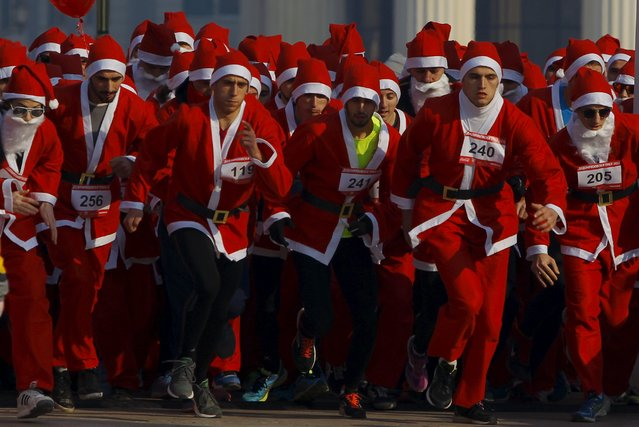 People dressed as Santa Claus run during a race in Skopje, Macedonia December 27, 2015. (Photo by Ognen Teofilovski/Reuters)