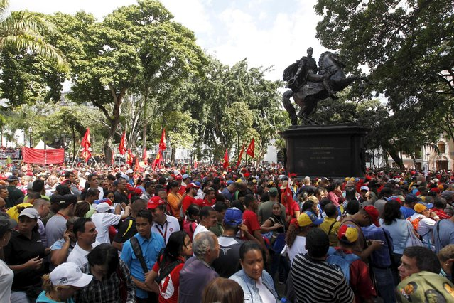 Supporters of Venezuela's President Nicolas Maduro gather at Plaza Bolivar near the building housing the National Assembly in Caracas, January 5, 2016. (Photo by Christian Veron/Reuters)