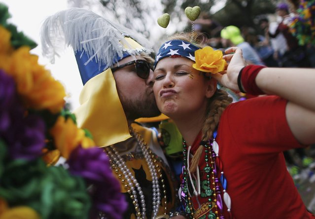 Revellers party on St. Charles Avenue during a Mardi Gras parade in New Orleans, Louisiana February 15, 2015. (Photo by Jonathan Bachman/Reuters)