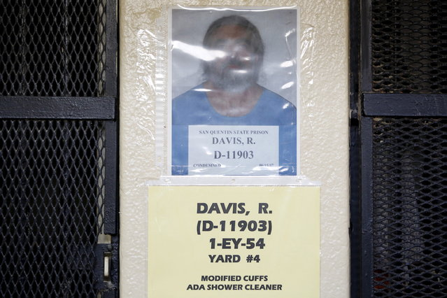 A photograph of Richard Allen Davis, who is on death row for murder, is seen posted on a wall outside his cell during a media tour of California's Death Row at San Quentin Stat, Prison in San Quentin, California December 29, 2015. (Photo by Stephen Lam/Reuters)