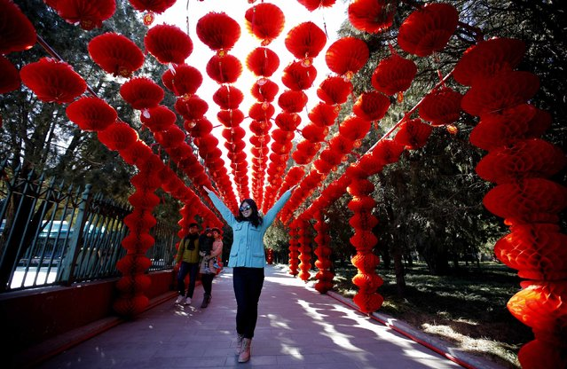 A woman poses under paper lanterns, celebrating the Chinese New Year, at Ditan Park, also known as the Temple of Earth, in Beijing, February 18, 2015. (Photo by Kim Kyung-Hoon/Reuters)