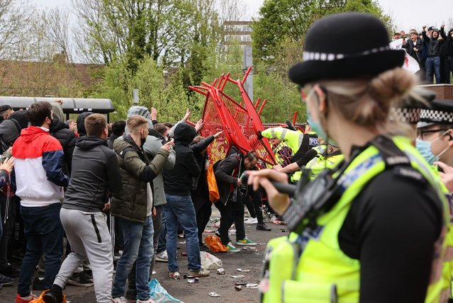 Fans and Police clash as Manchester United fans protest against their owners before the Manchester United v Liverpool Premier League match in Manchester, Britain on May 2, 2021. (Photo by Carl Recine/Action Images via Reuters)