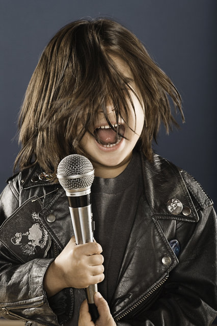 Boy (4-6) screaming at microphone. Date created: February 14, 2006. (Photo by Siri Stafford/Getty Images)