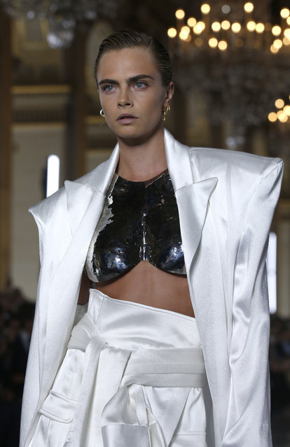 Cara Delevingne wears a creation for Balmain Spring/Summer 2019 ready-to-wear fashion collection in Paris, Friday, September 28, 2018. (Photo by Thibault Camus/AP Photo)