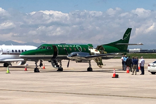 This image from CBS Denver shows a Key Lime Air Metroliner that landed safely at Centennial Airport after a mid-air collision near Denver on Wednesday, May 12, 2021. Federal officials say two airplanes collided but that there are no injuries. The collision between a twin-engine Fairchild Metroliner and a single-engine Cirrus SR22 happened as both planes were landing, according to the National Transportation Safety Board. Key Lime Air, which owns the Metroliner, says its aircraft sustained substantial damage to the tail section but that the pilot was able to land safely. (Photo by CBS Denver via AP Photo)