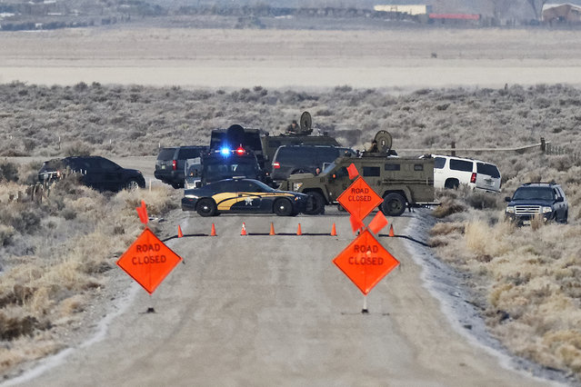 Law enforcement personnel block an access road to the Malheur National Wildlife Refuge, Wednesday, January 27, 2016, near Burns, Ore. Authorities were restricting access on Wednesday to the Oregon refuge being occupied by an armed group after one of the occupiers was killed during a traffic stop and eight more, including the group's leader Ammon Bundy, were arrested. (Photo by Thomas Boyd/The Oregonian via AP Photo)