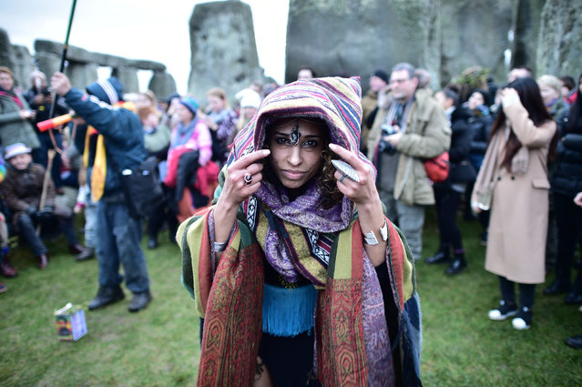 Druids, pagans and revellers gather in the centre of Stonehenge as they take part in a winter solstice ceremony at the ancient neolithic monument of Stonehenge near Amesbury on December 21, 2016 in Wiltshire, England. (Photo by Ben Birchall/PA Wire)