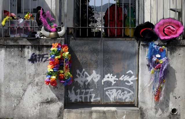 """Pieces of costumes hang on the entrance of a house during an annual block party known as """"Ceu na Terra"""" (Heaven on Earth), one of the many pre-carnival parties to take place in the neighbourhoods of Rio de Janeiro, Brazil, January 30, 2016. (Photo by Ricardo Moraes/Reuters)"""