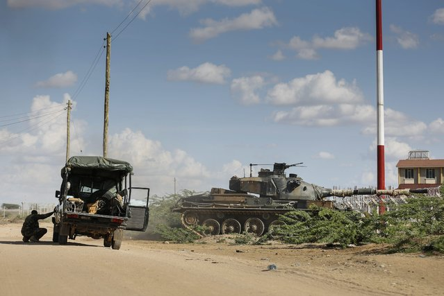 A tank moves into Garissa University campus as soldiers take cover in Garissa town, located near the border with Somalia, some 370 km northeast of the capital Nairobi, Kenya, 02 April 2015. (Photo by Dai Kurokawa/EPA)