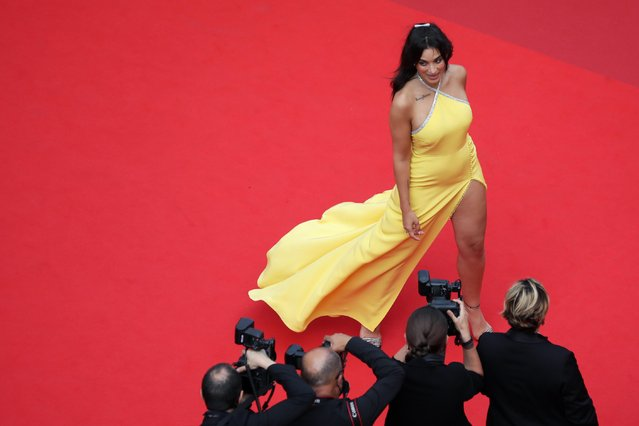 """French-Algerian singer and actress Camelia Jordana arrives for the screening of the film """"The French Dispatch"""" at the 74th edition of the Cannes Film Festival in Cannes, southern France, on July 12, 2021. (Photo by Reinhard Krause/Reuters)"""