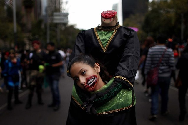 A girl dressed as zombie takes part in Mexico City's seventh annual Zombie Walk, on November 23, 2013.  (Photo by Edgard Garrido/Reuters)