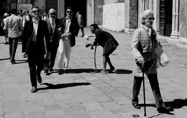 """""""Una moneta..."""" This photograph was taken during my walk in Venice (Italy). The beggar ask for coins, but everyone was ignoring him. Una Moneta – Only one coin, please, was the sentence he was continuously repeating... Photo location: Venice, Italy, EU. (Photo and caption by Charles Hodossy/National Geographic Photo Contest)"""