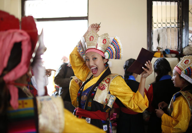"A Tibetan girl reacts as she gets ready to perform in a function organised to mark ""Losar"" or the Tibetan New Year in Kathmandu, Nepal, February 11, 2016. (Photo by Navesh Chitrakar/Reuters)"