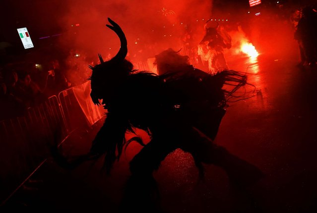 Participants dressed as the Krampus creature walk the streets in search of delinquent children during Krampus night in Neustift im Stubaital. (Photo by Sean Gallup)