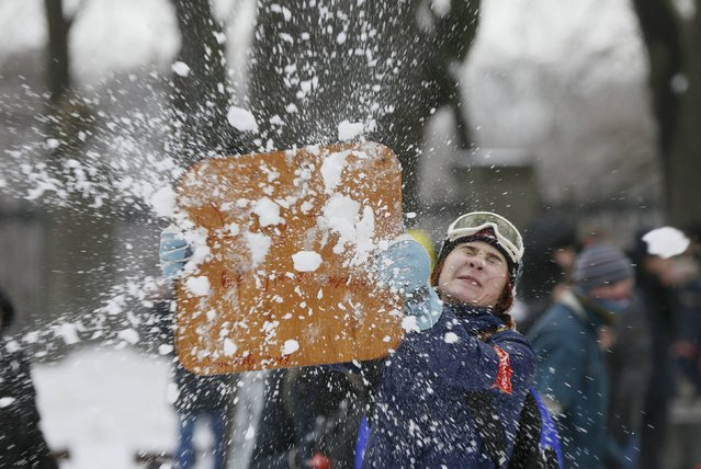 A woman enjoys a flash mob snowball fight in Kiev, Ukraine January 14, 2017. (Photo by Valentyn Ogirenko/Reuters)