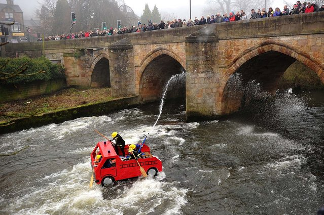 Participants take part in the Matlock raft race in Matlock, England, on December 26, 2013. The Derbyshire Association of Sub-Aqua Clubs organize the Matlock Raft Race in aid of the RNLI (lifeboats). It has been running for over 47 years and has raised more than £200,000. The race starts on the River Derwent in Matlock and finishes at Cromford Meadows two miles downstream. (Photo by Bethany Clarke/Getty Images)