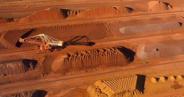A bucket wheel reclaimer collects ore at the BHP Billiton iron ore loading facility in Port Hedland, north of Perth, Australia in this May 26, 2008 file photo. Top global miner BHP Billiton slashed its interim dividend by 75 percent on February 23, 2016, abandoning a long-held policy of steady or higher payouts as it braces for a longer-than-expected commodities downturn. (Photo by Tim Wimborne/Reuters)