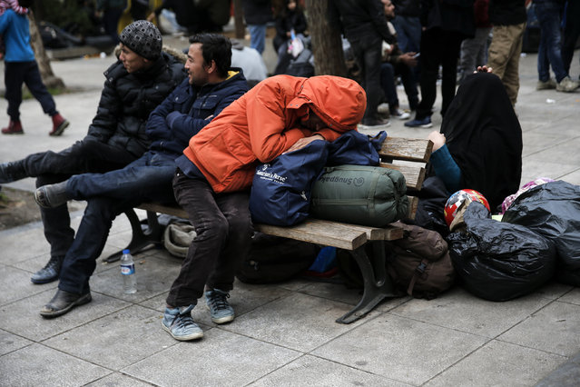 A stranded Afghan migrant sleeps on his belongings on Victoria square in Athens, Greece, February 24, 2016. (Photo by Alkis Konstantinidis/Reuters)
