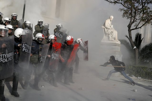 An anti-establishment protester tries to attack riot police during a protest against high security prisons in Athens, in this April 16, 2015 file photo. (Photo by Alkis Konstantinidis/Reuters)