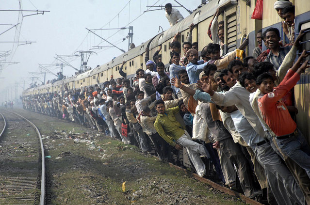 Passengers travel in an overcrowded train in the eastern Indian city of Patna, February 23, 2010. (Photo by Krishna Murari Kishan/Reuters)