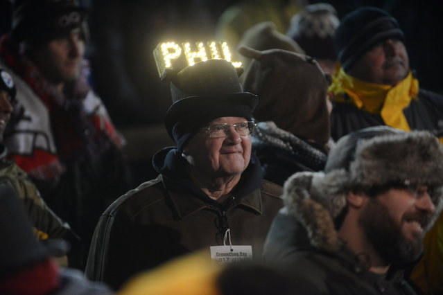 Barry Edwards of Lancaster, PA, wears a homemade lighted Phil hat at Gobbler's Knob on the 131st Groundhog Day in Punxsutawney, Pennsylvania, U.S. February 2, 2017. Punxsutawney Phil, a famed U.S. groundhog emerged from his burrow on Thursday and predicted six more weeks of winter weather. (Photo by Alan Freed/Reuters)