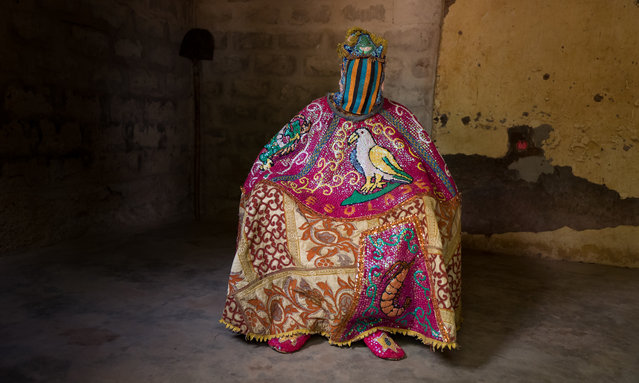A member of an Egungun masquerade group, his identity obscured under his ornate costume in Ouidah, Benin on March 13, 2019. The exclusively male practitioners, found across Yoruba culture, use dance and spinning in the belief that they will summon the spirits of ancestors. (Photo by Massimo Rumi/Barcroft Images)