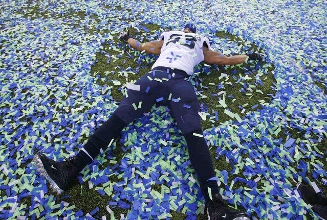 Seattle Seahawks Malcom Smith makes an angel in the confetti after his team defeated the Denver Bronocs in the NFL Super Bowl XLVIII football game in East Rutherford, New Jersey, February 2, 2014. (Photo by Shannon Stapleton/Reuters)
