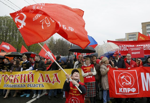 Supporters of Russia's Communist party carry banners and flags during a May Day rally in Moscow May 1, 2015. (Photo by Maxim Shemetov/Reuters)