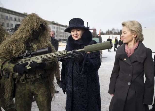 German Defense Minister Ursula von der Leyen, right, and Lithuania's Presidend Dalia Grybauskaite speaks with a soldier during the NATO enhanced forward presence battalion welcome ceremony at the Rukla military base some 130 km (80 miles) west of the capital Vilnius, Lithuania, Tuesday, February 7, 2017. The NATO enhanced forward presence battalion in Lithuania will be led by framework nation Germany. (Photo by Mindaugas Kulbis/AP Photo)