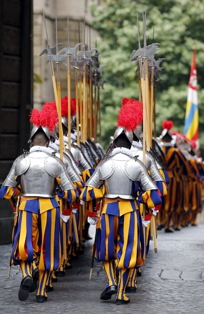 New recruits of the Vatican's elite Swiss Guard march during the swearing-in ceremony at the Vatican May 6, 2015. (Photo by Giampiero Sposito/Reuters)
