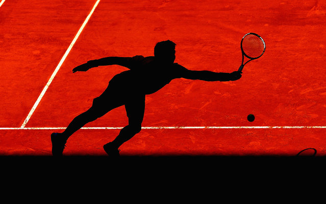 Fernando Verdasco of Spain in action against Marin Cilic of Croatia in their second round match during day five of the Mutua Madrid Open tennis tournament at the Caja Magica  on May 6, 2015 in Madrid, Spain. (Photo by Clive Brunskill/Getty Images)