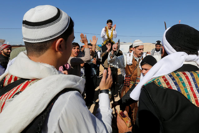 The Syrian refugee folklore troupe Abu Rustom perform at a wedding show at Zaatari refugee camp in the Jordanian city of Mafraq, near the border with Syria February 20, 2017. The Syrian troupe is trying to keep its country's traditions alive by holding traditional dances and performing celebratory sword fights during weddings and other occasions, according to the troupe's leader. (Photo by Muhammad Hamed/Reuters)