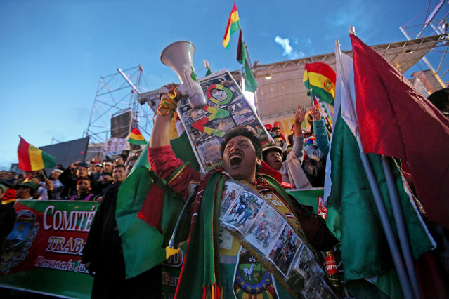 Demonstrators take part in a march against the re-election of Bolivian President Evo Morales in La Paz, Bolivia, 21 February 2017. (Photo by Martin Alipaz/EPA)