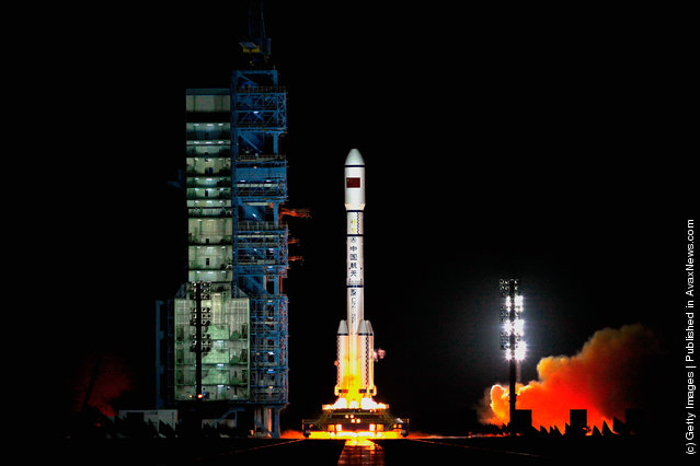 A Long March 2F rocket carrying the country's first space laboratory module Tiangong-1 lifts off from the Jiuquan Satellite Launch Center