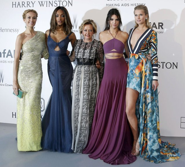 (L-R) Model Petra Nemcova, model Jourdan Dunn, Vice-president of Chopard Caroline Gruosi-Scheufele, model Kendall Jenner and model Toni Garrn pose during a photocall as they arrive to attend the amfAR's Cinema Against AIDS 2015 event during the 68th Cannes Film Festival in Antibes, near Cannes, southern France, May 21, 2015. (Photo by Regis Duvignau/Reuters)