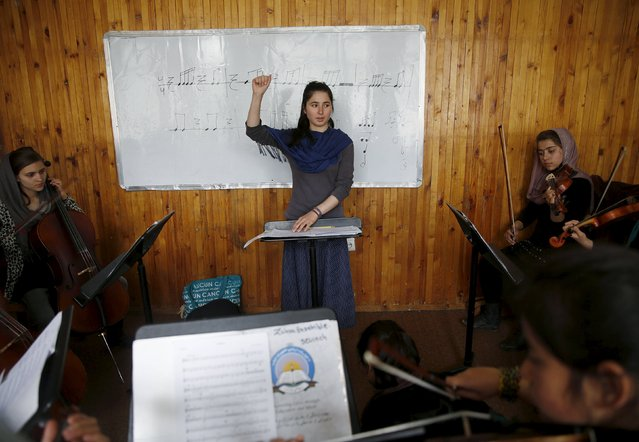 Negin Ekhpulwak, leader of the Zohra orchestra, an ensemble of 35 women, conducts during a rehearsal at Afghanistan's National Institute of Music, in Kabul, Afghanistan April 9, 2016. (Photo by Ahmad Masood/Reuters)