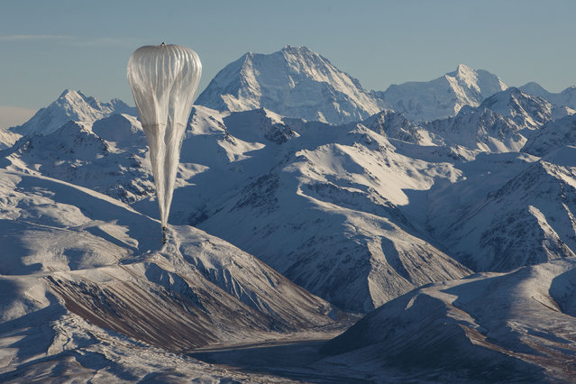A Loon internet balloon, carrying solar-powered mobile networking equipment, flies over rugged terrain in New Zealand in this photo provided June 29, 2019. (Photo by Courtesy Loon/Handout via Reuters)