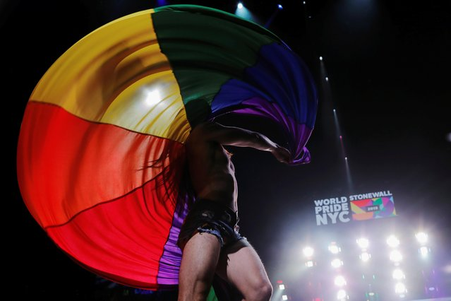 A performer dances on stage during the WorldPride 2019 Opening Ceremony, a combined celebration marking the 50th anniversary of the 1969 Stonewall riots and WorldPride 2019 in New York, U.S., June 26, 2019. (Photo by Lucas Jackson/Reuters)