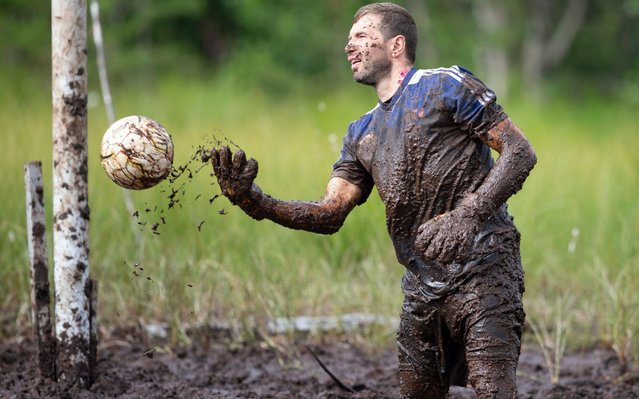 The goalkeeper in action during the Swamp Soccer Championships 2019 in Hyrynsalmi, Finland, 19 July 2019. (Photo by Tomi Hanninen/EPA/EFE/Rex Features/Shutterstock)
