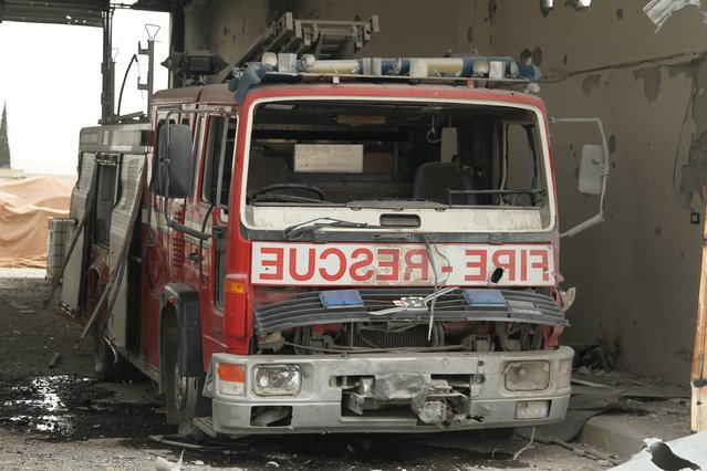A damaged Civil Defence truck is pictured inside a rescue station in the rebel held town of Atareb, Aleppo countryside, Syria April 26, 2016. (Photo by Ammar Abdullah/Reuters)